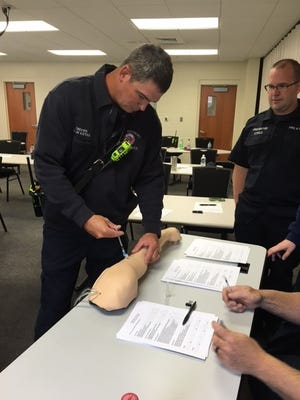 Captain/AEMT Clay Estes practices administering an Ephiniphrine shot.
