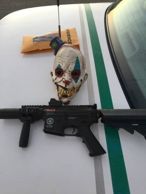The mask and Airsoft gun confiscated by authorities.
