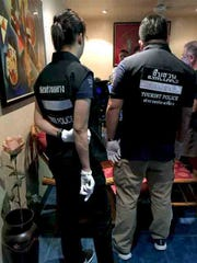 Overseas, Thai police officers monitor a sting operation