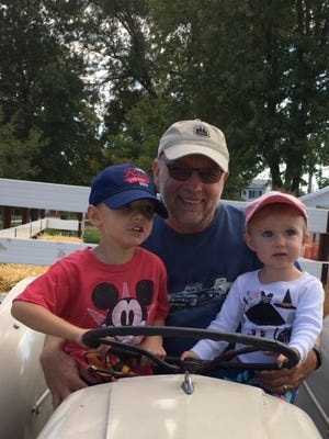 Ken Stempien, president of the Friends of the Wilson Barn, with two of his grandchildren, Anna and Andrew Ziolkowski, at Pumpkin Fest.