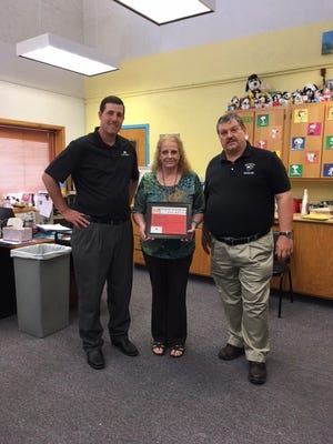 Hondo teacher Natalie Smith is honored for service.