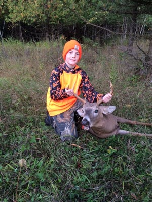 Drew Daoust - 10 of Brussels shot this 8 point buck, his first deer, in Door County while hunting his first day of the youth hunt.