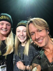 "Friends Parker and Addie were invited on stage at Friday's concert, where they sang a bit of Taylor Swift's ""Trouble"" and posed for a selfie with Keith Urban."