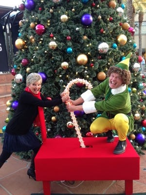Beth McDonald and Fox 10's Cory McCluskey get set for all-day Christmas music on KEZ 99.9.