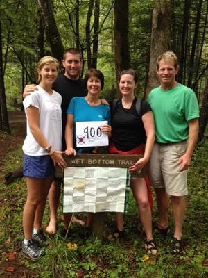 The Carey family celebrated when mom Ruthie joined the 900-mile Club, having hiked all 900 miles of trails in the Great Smoky Mountains National Park. Pictured with her family, from left, are daughter Landis, son Nick, Ruthie, daughter Allie and husband Bart Carey.