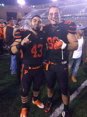 Mark Fossati and Kurt Holuba celebrate Princeton's Ivy League title with a cigar (disclaimer - kids, don't smoke).