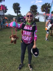 Sarah Woods Nesmith shows off the bear she will jump