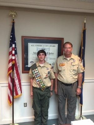 Shown are Nicholas Wooley and his Scout leader James Lawrence.
