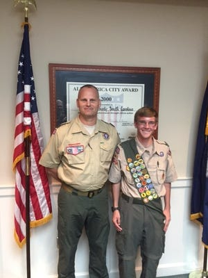 Shown are Trevor Cook and his Scout leader, Ed Amen.