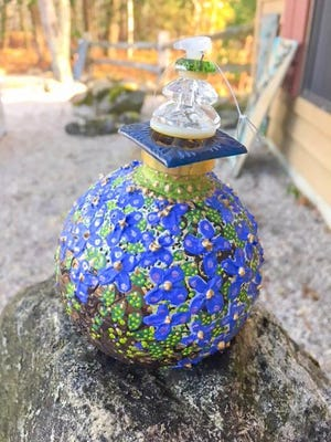 "Handpainted glass by Mary White, part of ""Art Show 12: The Ornaments Show"" Dec. 3 at Plum Bottom Pottery & Gallery."