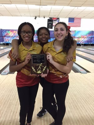From left: Edison's Touri Holmes, Victoria Johnson and Samantha Salzone.