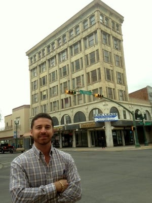 Benjamin Marcus, managing partner for a group of young El Paso investors, stands outside the 106 year-old Abdou building that the group purchased at Mesa and Texas in Downtown El Paso.