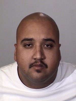 Sandoval was arrested after being found with a loaded, stolen firearm with ammunition.