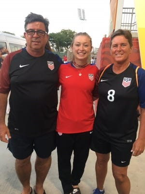 Soccer and philanthropy were on the agenda in Papua New Guinea for Canton's (from left) David, Courtney and Lisa Petersen. Courtney competed with the U.S. Under-20 Women's National Team.