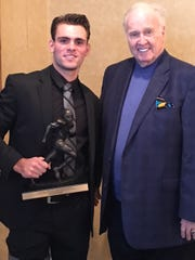 Lafayette quarterback Walker Wood and Paul Hornung at the ceremony where Wood accepted the Paul Hornung Award from the Louisville Quarterback Club.