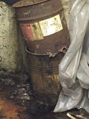 These photos provided by the Michigan Department of Environmental Quality show conditions inside Electro-Plating Service on 10 Mile Road in Madison Heights, which has been ordered to cease operations because of concerns over improper storage of hazardous chemicals.