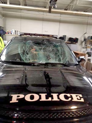 A Menasha Police Department squad car was damaged when a 25-year-old man jumped on its windshield, according to police.