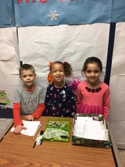 Kindergarten students at Kennedy Elementary School sold Snack-o-Grams to raise money for activity gift bags for Goryeb Children's Hospital. Pictured left to right are Nash Burger, Jocelyn Tidwell, and Savannah Clemente.