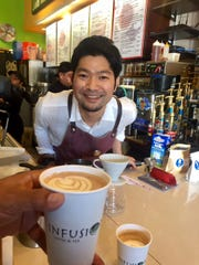 Yoshikazu Iwase, Japan's barista champion for the past two years, shares his talents at Infusion Coffee & Tea's Upper Tumon cafe on Tuesday, Jan. 17, 2017.