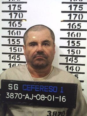 """In this Jan. 8, 2016, file photo released by Mexico's federal government, drug lord Joaquin """"Chapo"""" Guzmán poses for his prison mug at the Altiplano maximum security federal prison in Almoloya, Mexico."""