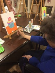 Doris Laswell, a resident of Baptist Retirement Community, looks forward to attending the painting every other week.