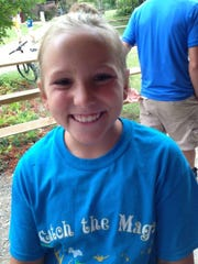 Cancer survivor Lucy Yungblut in 2014 at the Cincinnati Children's Hospital summer camp at Camp Joy for children with pediatric cancer or blood disease.
