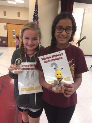Tuloso-Midway Intermediate School spelling bee champion Anokhi Bhakta (right) and runner-up Emily Battersby.