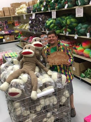 Craig Spadoni of Bead Busters and Float Rentals poses with his favorite Mardi Gras throw, the Sock Monkey.