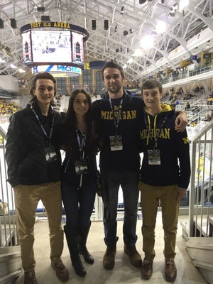 Jacob, Nicole, Kyle and Dakota Truscott pose for a picture during Jacob Truscott's visit to Michigan. Jacob, a Port Huron Northern freshman, committed to play for the Wolverines.