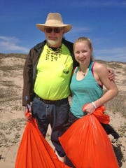 Michaela Hummell, 17, has been volunteering at the Big Shell Beach Cleanup for more than half her life.