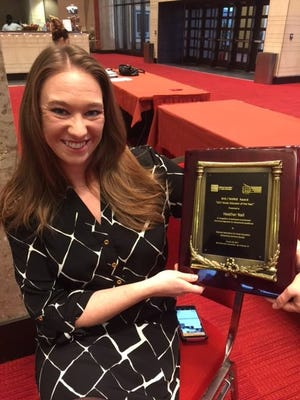 Valley Southwoods vocal music director Heather Nail with her music educator award.
