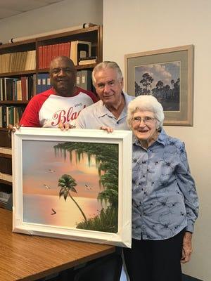 Highwaymen artist Al Black, Vero Beach philanthropist Jerry Morabito and Mary Rice, the winner of the Al Black original oil painting