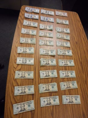 After verifying an anonymous tip, IMPD officers were able to serve search warrants at two Indianapolis locations, confiscating marijuana, heroin, cocaine and $10,000.
