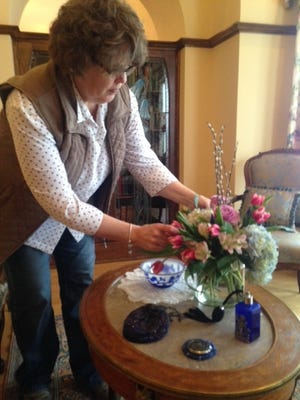 Florist Charmaine Prewitt from Blossoms and Bows checks floral arrangements at the Yawkey House Museum, in preparation for Houses in Bloom in 2016.