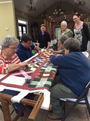 Women quilt at a Fort Donelson quilting event in Dover, Tennessee.