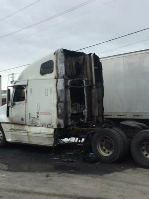 A semi-tractor was heavily damaged in a fire early Monday morning in Scott.