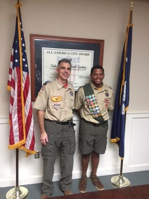 Shown are Tyren Wright who has achieved his Eagle Scout rank, at right, and his Scout Leader, Dion Jones, at left.