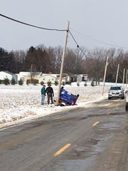 Three people suffered minor injuries Monday afternoon in a one-vehicle rollover crash on Plymouth-Springmill Road.