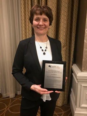 Clintonville's Karen Petermann holds her award as SHAPE America's national elementary physical education teacher of the year.