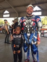 Aiden Coleman, 7, spends time with his mentor, Jason