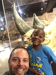 Jason Redmon and Aiden Coleman, 7, spend time at the