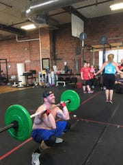 Rob Lash competed in the Crossfit Katana Open at the Fitness Factory gym on Mulberry Street March 24.