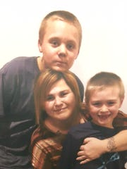 Tina Polly and sons Grayden, 7, and Logan, 14.