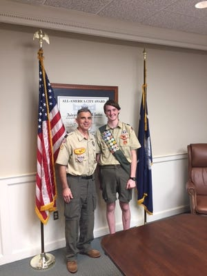 Jackson Potter, left, and his Scout leader, Dion Jones are photographed at his Eagle Scout Board of Review held on March 31.