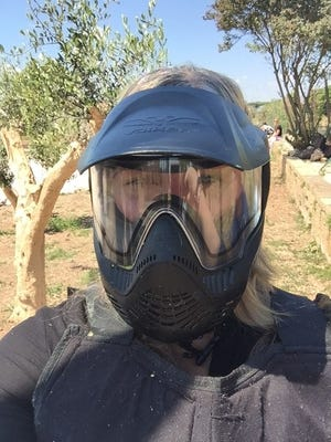 Angelique is ready for some paintball action -- but don't mess up the shoes!