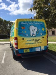 This brightly wrapped van reminds residents of the basics for healthy teeth.