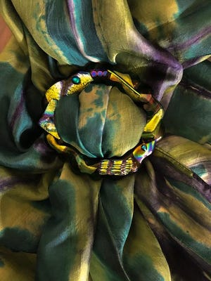 A fused scarf slide decorates this hand-dyed scarf by Kara DeBacker.