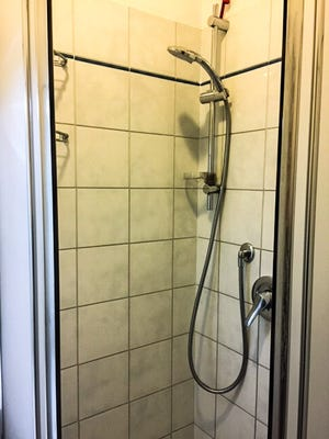 Compact shower stalls are common in Europe.