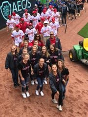 """The Milford girls softball team takes part in """"March at the Majors"""" April 23 before the Reds/Cubs game."""