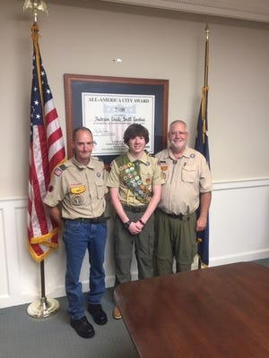 Shown is Hunt Little who earned Eagle Scout rank with his Scout leaders, Bil Masek and Ricky Murphy at his Eagle Scout Board Review.